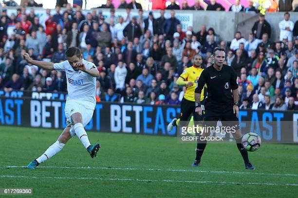 Swansea City's Icelandic midfielder Gylfi Sigurdsson has an unsuccessful shot on goal during the English Premier League football match between...