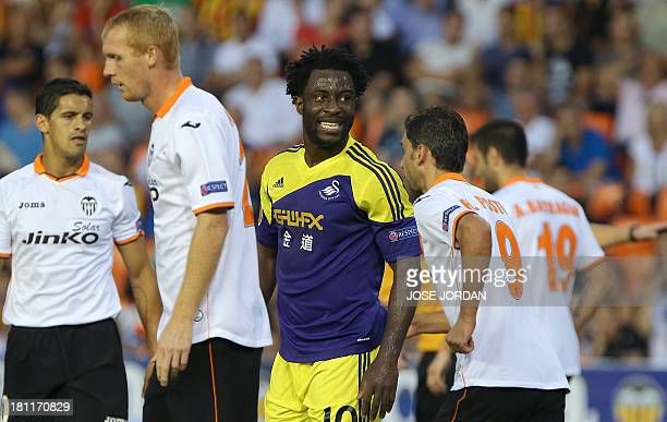 Swansea City's Ivorian striker Wilfried Bony smiles during the UEFA Europa league football match Valencia CF vs Swansea City AFC at the Mestalla...