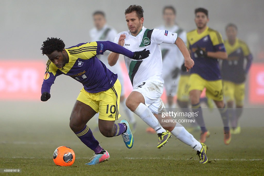 Swansea City's Ivorian striker Wilfried Bony (L) vies with St Gallen's Macedonian midfielder Muhamed Demiri during the Europa League Group A football match FC St Gallen vs Swansea City on December 12, 2013 at the AFG Arena in St Gallen.