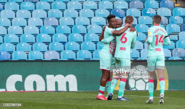Swansea City's Jamal Lowe celebrates scoring the opening goal with Andre Ayew and Jay Fulton during the Sky Bet Championship match between Sheffield...