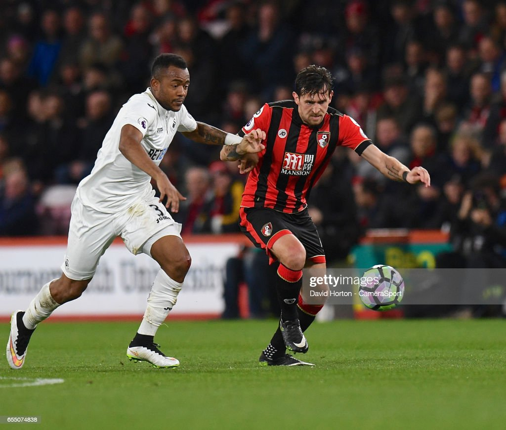 Swansea City's Jordan Ayew (L) battles with Bournemouth's Charlie Daniels (R) during the Premier League match between AFC Bournemouth and Swansea City at Vitality Stadium on March 18, 2017 in Bournemouth, England.