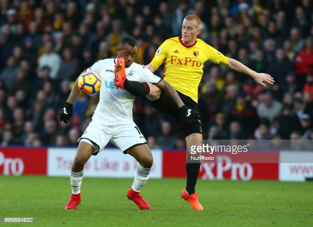 Swansea City's Jordan Ayew gets beaten by Watford's Ben Watson during Premier League match between Watford and Swansea City at Vicarage Road Stadium...