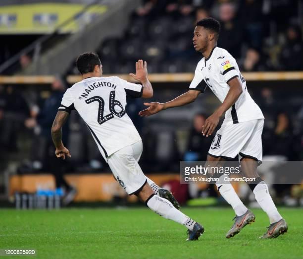 Swansea City's Jordan Garrick, right, celebrates scoring his side's third goal with team-mate Kyle Naughton during the Sky Bet Championship match...