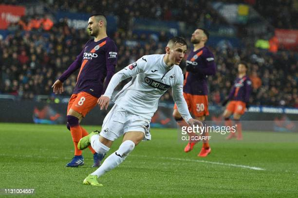 Swansea City's Kosovan midfielder Bersant Celina celebrates after scoring their second goal during the FA Cup quarterfinal football match between...