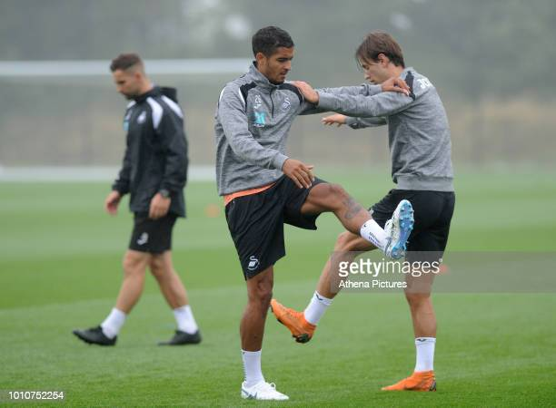 Swansea City's Kyle Naughton and Bersant Celina in action during the Swansea City Training Session at The Fairwood Training Ground on August 02 2018...