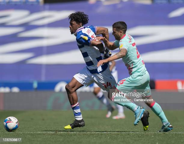 Swansea City's Kyle Naughton battles for possession with Reading's Ovie Ejaria during the Sky Bet Championship match between Reading and Swansea City...