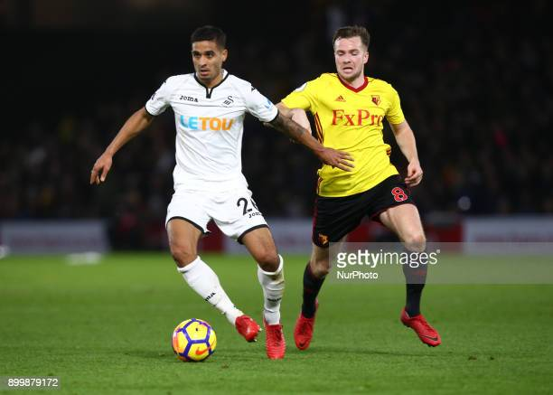 Swansea City's Kyle Naughton holds of Watford's Tom Cleverley during Premier League match between Watford and Swansea City at Vicarage Road Stadium...