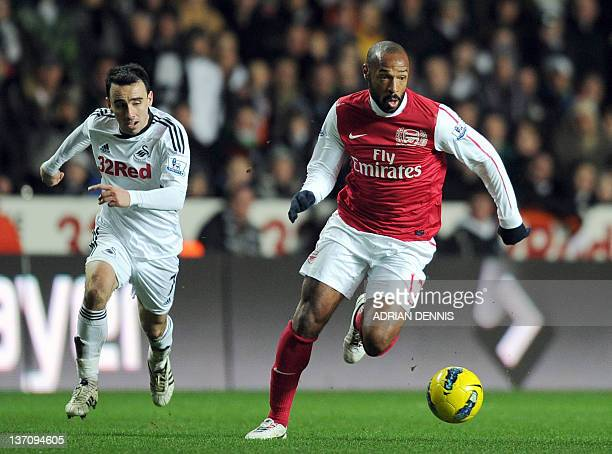 Swansea City's Leon Britton chases after Arsenal's Thierry Henry during the English Premiership football match at the Liberty Stadium in Swansea on...