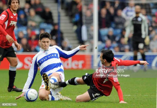 Swansea City's Leon Britton tackles Queens Park Rangers' Alejandro Faurlin during the CocaCola Championship match at Loftus Road London