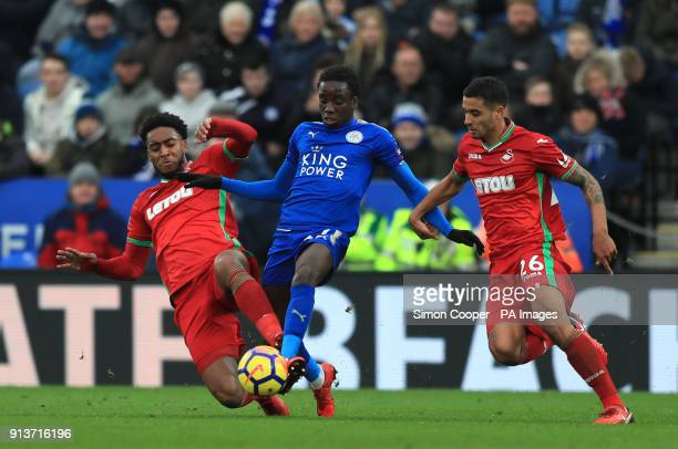 Swansea City's Leroy Fer and Martin Olsson battle with Leicester City's Fousseni Diabate during the Premier League match at the King Power Stadium...