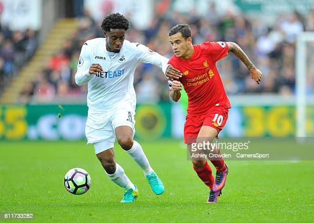 Swansea City's Leroy Fer vies for possession with Liverpool's Philippe Coutinho during the Premier League match between Swansea City and Liverpool at...