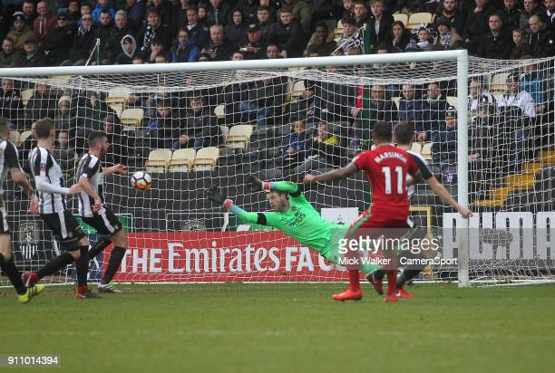 Swansea City's Luciano Narsingh scores his sides first goal beating Notts County's Adam Collin during the The Emirates FA Cup Fourth Round match...