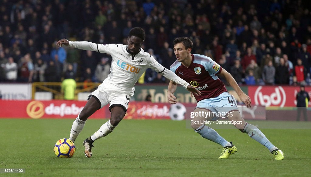 Swansea City's Nathan Dyer under pressure from Burnley's Jack Cork during the Premier League match between Burnley and Swansea City at Turf Moor on November 18, 2017 in Burnley, England.