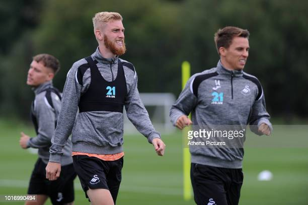 Swansea City's Oli McBurnie and Tom Carroll in action during the Swansea City Training at The Fairwood Training Ground on August 14 2018 in Swansea...