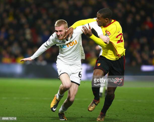 Swansea City's Oliver McBurnie tussle with Watford's Christian Kabasele during Premier League match between Watford and Swansea City at Vicarage Road...
