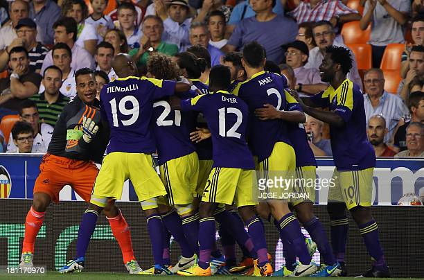 Swansea City's players celebrate their third score during the UEFA Europa league football match Valencia CF vs Swansea City AFC at the Mestalla...
