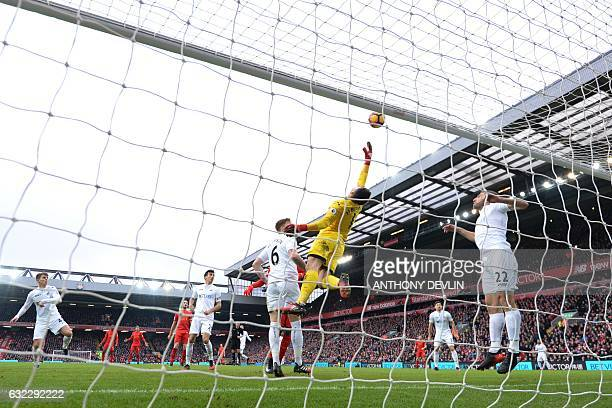 Swansea City's Polish goalkeeper Lukasz Fabianski dives for a ball that went over the bar during the English Premier League football match between...
