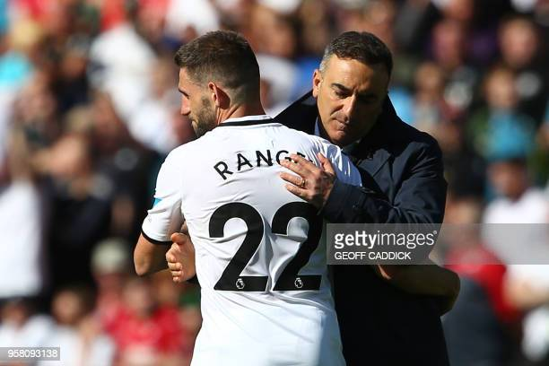 Swansea City's Portuguese manager Carlos Carvalhal embraces Swansea City's Spanish defender Angel Rangel during the English Premier League football...