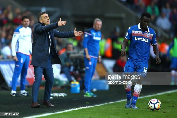 Swansea City's Portuguese manager Carlos Carvalhal gestures during the English Premier League football match between Swansea City and Stoke City at...