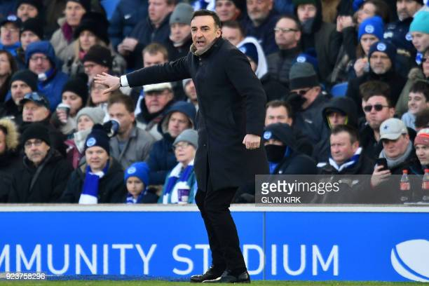 Swansea City's Portuguese manager Carlos Carvalhal gestures on the touchline during the English Premier League football match between Brighton and...