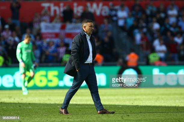 Swansea City's Portuguese manager Carlos Carvalhal leaves the pitch after losing the English Premier League football match between Swansea City and...