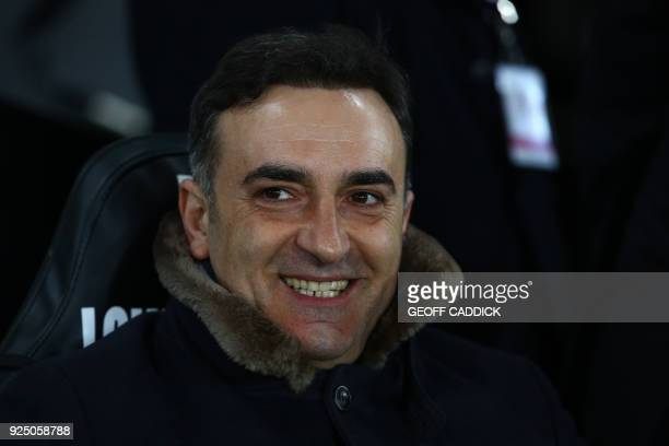 Swansea City's Portuguese manager Carlos Carvalhal looks on before the English FA Cup 5th round replay football match between Swansea City and...