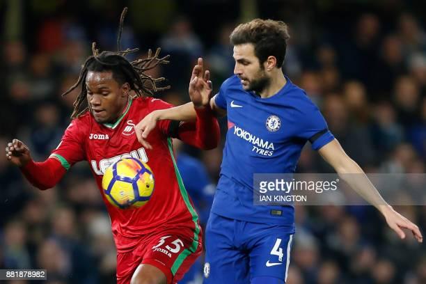 Swansea City's Portuguese midfielder Renato Sanches vies with Chelsea's Spanish midfielder Cesc Fabregas during the English Premier League football...