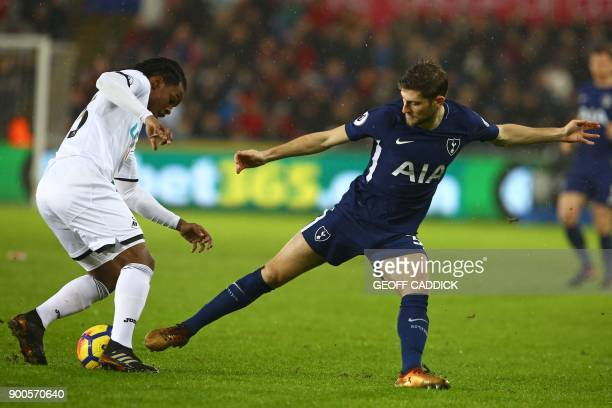 Swansea City's Portuguese midfielder Renato Sanches vies with Tottenham Hotspur's Welsh defender Ben Davies during the English Premier League...