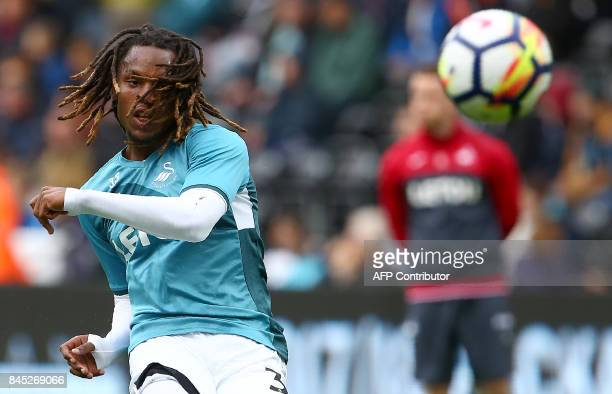 Swansea City's Portuguese midfielder Renato Sanches warms up ahead of the English Premier League football match between Swansea City and Newcastle...