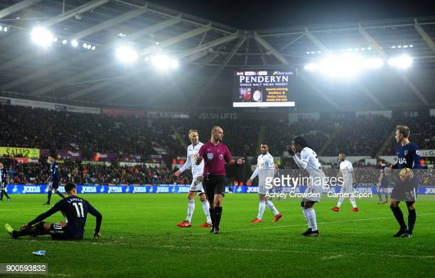 Swansea City's Renato Sanches reacts after fouling Tottenham Hotspur's Erik Lamela during the Premier League match between Swansea City and Tottenham...