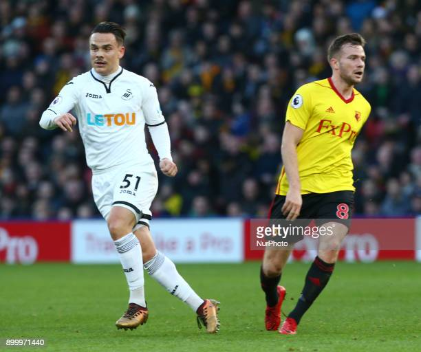 LR Swansea City's Roque Mesa and Watford's Tom Cleverley during Premier League match between Watford and Swansea City at Vicarage Road Stadium...