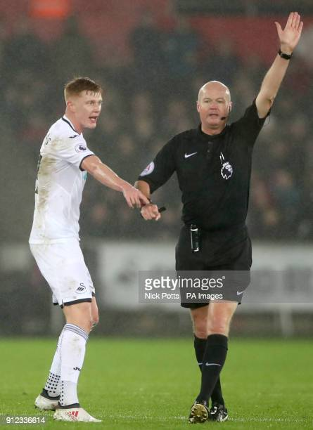 Swansea City's Sam Clucas appeals to match referee Lee Mason during the Premier League match at the Liberty Stadium Swansea