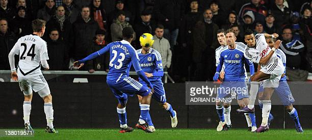 Swansea City's Scott Sinclair volleys the ball to score the opening goal against Chelsea during the Premiership match at The Liberty Stadium in...