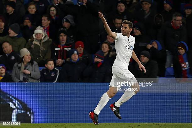 Swansea City's Spanish defender Angel Rangel celebrates after scoring their second goal during the English Premier League football match between...