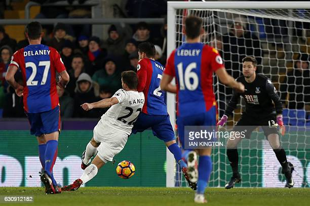 Swansea City's Spanish defender Angel Rangel shoots to score their second goal during the English Premier League football match between Crystal...