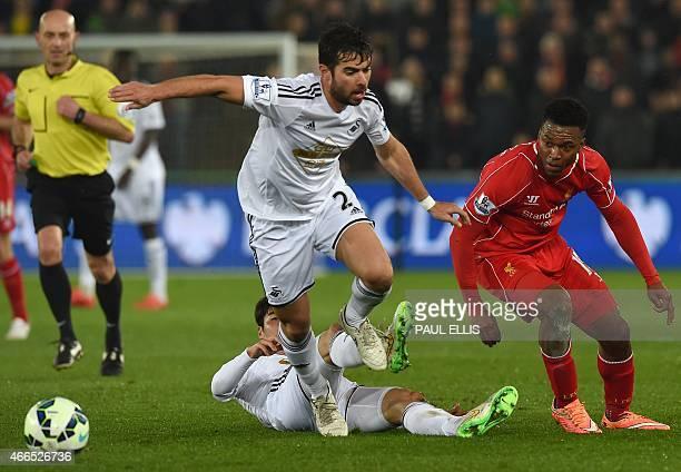 Swansea City's Spanish defender Jordi Amat and Swansea City's Korean midfielder Ki SungYueng vie for the ball Liverpool's English striker Daniel...