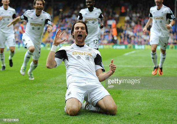 Swansea City's Spanish midfielder Miguel Michu celebrates scoring his team's first goal during the English Premier League football match between...