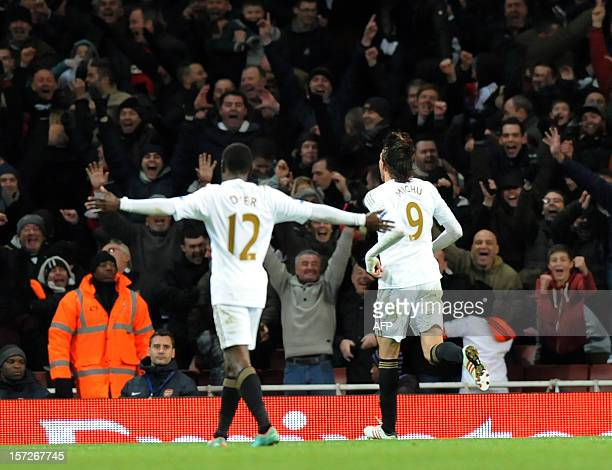 Swansea City's Spanish midfielder Miguel Michu celebrates scoring during the English Premier League football match between Arsenal and Swansea City...