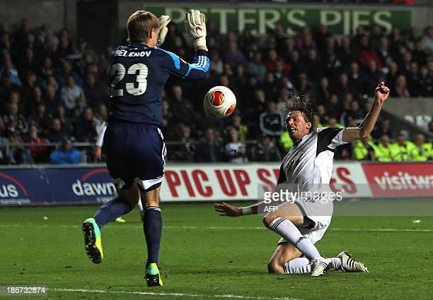 Swansea City's Spanish midfielder Miguel Michu scores the opening goal past Kuban Krasnodar's Russian goalkeeper Aleksandr Belenov during the UEFA...