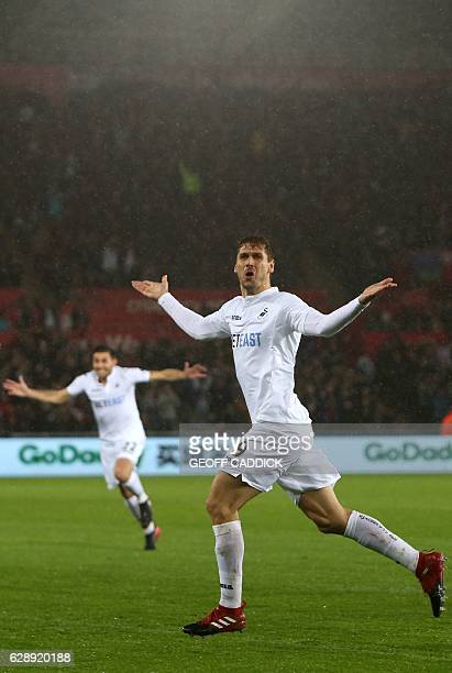 Swansea City's Spanish striker Fernando Llorente celebrates after scoring their second goal during the English Premier League football match between...