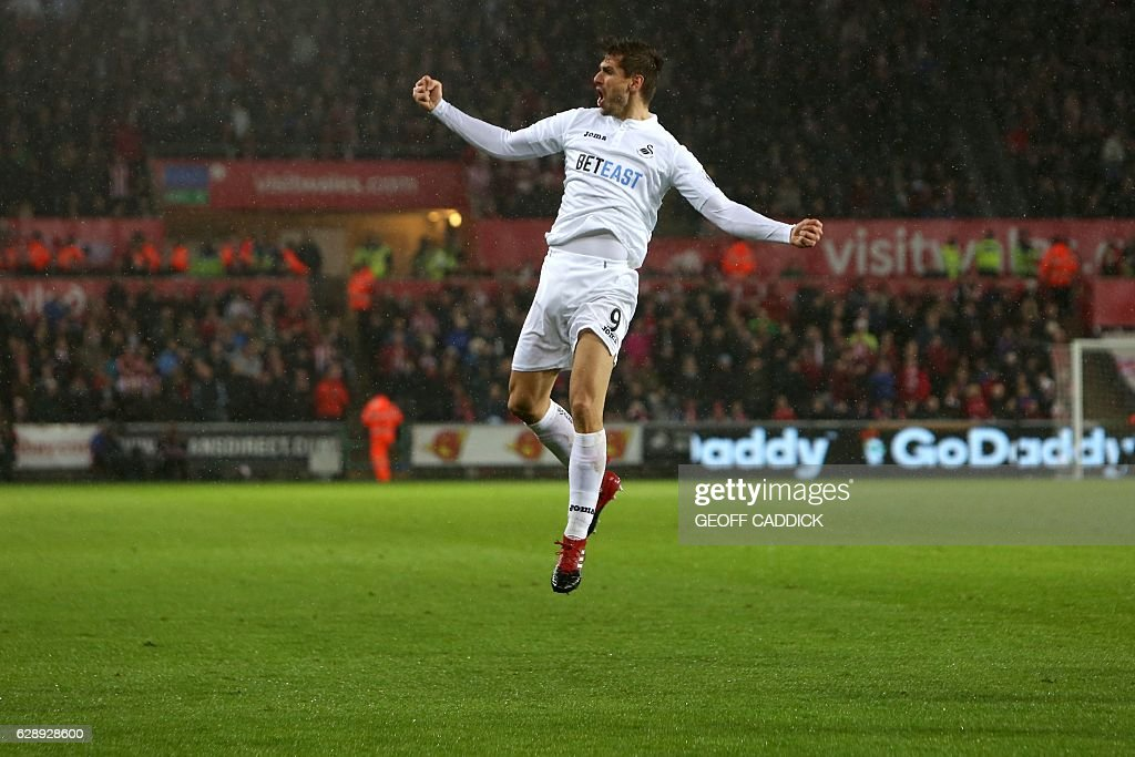 Swansea City's Spanish striker Fernando Llorente celebrates after scoring their second goal during the English Premier League football match between Swansea City and Sunderland at The Liberty Stadium in Swansea, south Wales on December 10, 2016. / AFP / Geoff CADDICK / RESTRICTED TO EDITORIAL USE. No use with unauthorized audio, video, data, fixture lists, club/league logos or 'live' services. Online in-match use limited to 75 images, no video emulation. No use in betting, games or single club/league/player publications. /