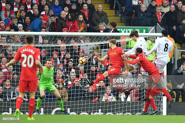 Swansea City's Spanish striker Fernando Llorente rises high to head the ball and score their second goal during the English Premier League football...