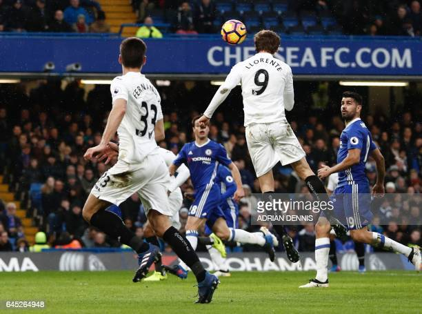 Swansea City's Spanish striker Fernando Llorente scores an equalising goal for 11 during the English Premier League football match between Chelsea...