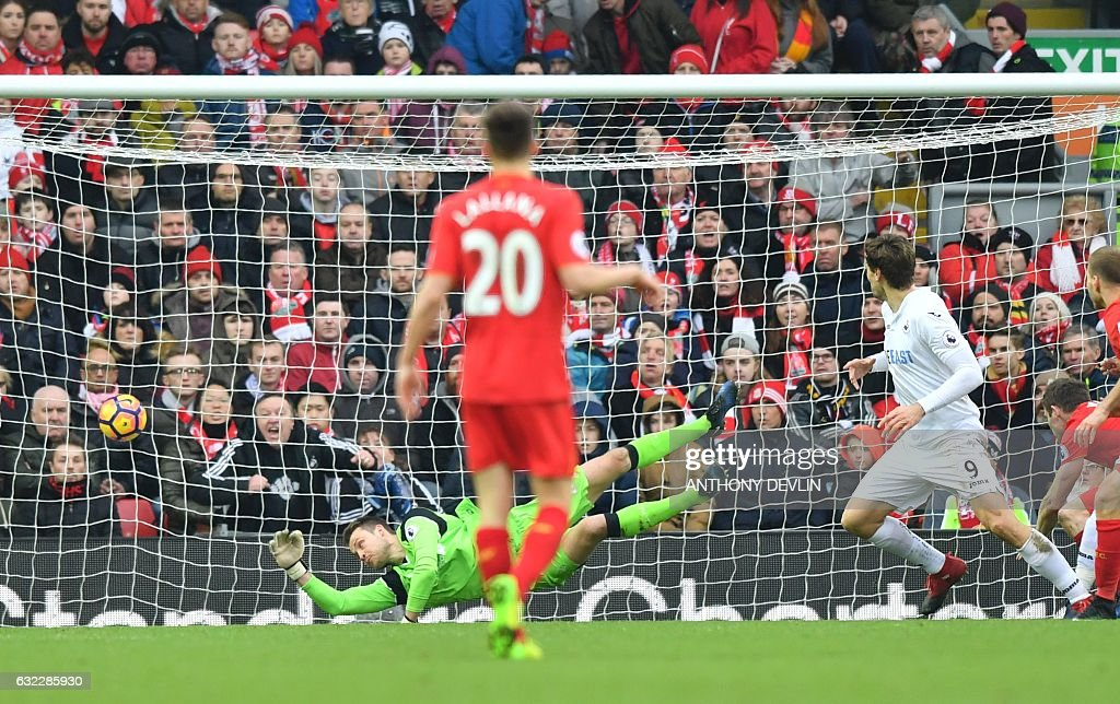 Swansea City's Spanish striker Fernando Llorente (R) scores their second goal during the English Premier League football match between Liverpool and Swansea City at Anfield in Liverpool, north west England on January 21, 2017. / AFP / Anthony DEVLIN / RESTRICTED TO EDITORIAL USE. No use with unauthorized audio, video, data, fixture lists, club/league logos or 'live' services. Online in-match use limited to 75 images, no video emulation. No use in betting, games or single club/league/player publications. /