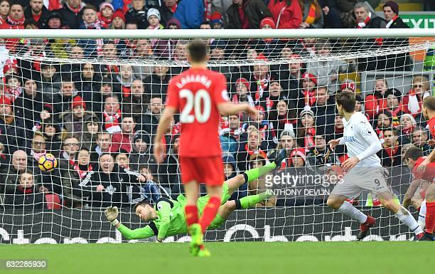 Swansea City's Spanish striker Fernando Llorente scores their second goal during the English Premier League football match between Liverpool and...