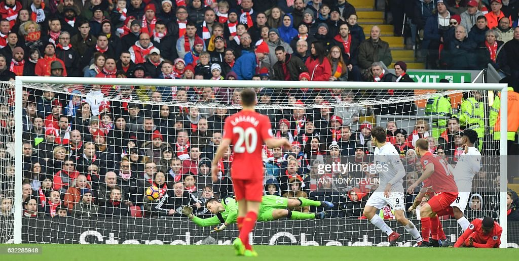 Swansea City's Spanish striker Fernando Llorente (4R) scores their second goal during the English Premier League football match between Liverpool and Swansea City at Anfield in Liverpool, north west England on January 21, 2017. / AFP / Anthony DEVLIN / RESTRICTED TO EDITORIAL USE. No use with unauthorized audio, video, data, fixture lists, club/league logos or 'live' services. Online in-match use limited to 75 images, no video emulation. No use in betting, games or single club/league/player publications. /