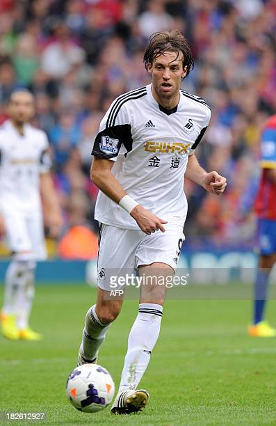 Swansea City's Spanish striker Miguel Michu controls the ball during the English Premier League football match between Crystal Palace and Swansea...