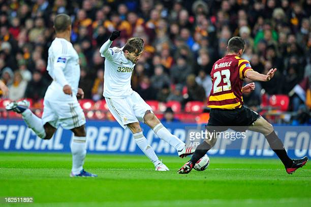 Swansea City's Spanish striker Miguel Michu shoots in the build up to their opening goal in the League Cup final football match between Bradford City...