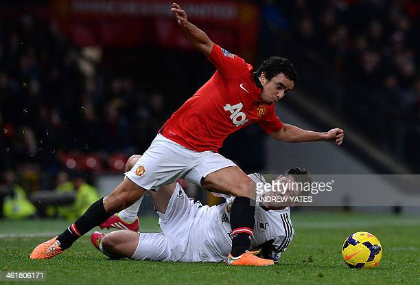 Swansea City's Welsh defender Ben Davies vies with Manchester United's Brazilian defender Rafael during the English Premier League football match...