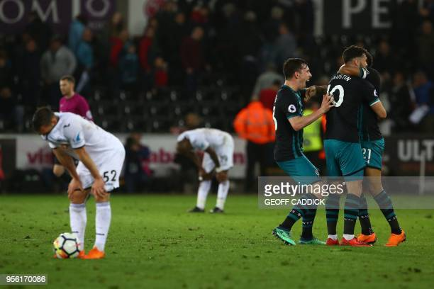 Swansea City's Welsh defender Connor Roberts reacts as Southampton's English striker Charlie Austin and Southampton's English defender Ryan Bertrand...